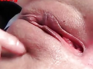 Japanese babe peels off and displays her smooth pussy in close-up