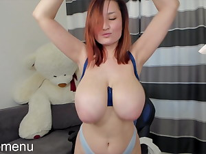 Petite redhead babe bouncing her HUGE boobs!
